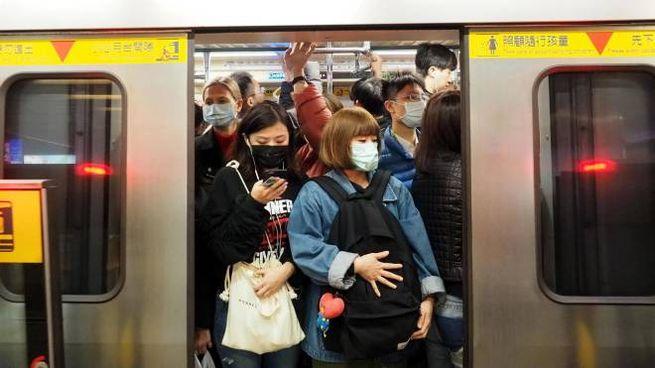 Le mascherine sono usate dai cinesi non appena hanno un raffreddore