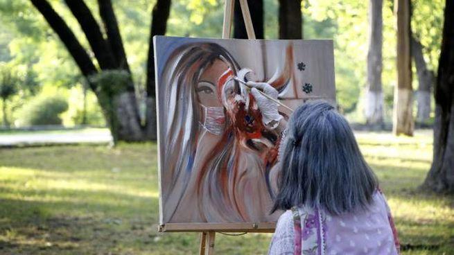 Pakistan, sessione di pittura a Islamabad (Ansa)