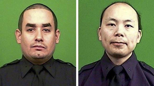 A combo handout picture released by the New York City Police Department (NYPD) on 21 December 2014 show officers Rafael Ramos (L) and Wenjian Liu (R), who were, according to NYPD Commissioner William Bratton, assassinated while sitting in their patrol car in the Brooklyn borough of New York, New York, USA, 20 December 2014. The shooter reportedly walked up to the passenger side of the car and shot both officers in the head before they had a chance to draw their weapons and respond. He was later reportedly found dead of a self-inflicted gunshot wound in a subway.  ANSA /NYPD BEST QUALITY AVAILABLE HANDOUT EDITORIAL USE ONLY/NO SALES