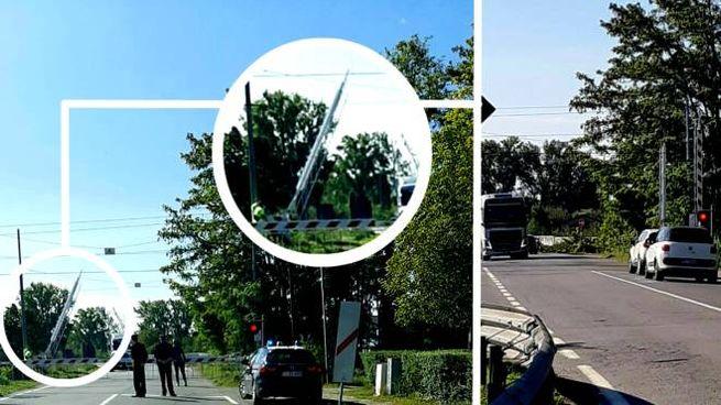A destra, le sbarre alzate e il semaforo rosso. A sinistra, i carabinieri che presidiano