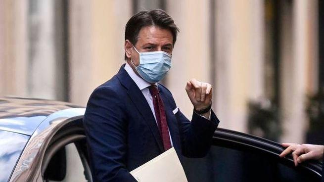 Italian Premier Giuseppe Conte as he leaves the house to go to the Quirinale, Rome, Italy, 27 January 2021. ANSA/RICCARDO ANTIMIANI