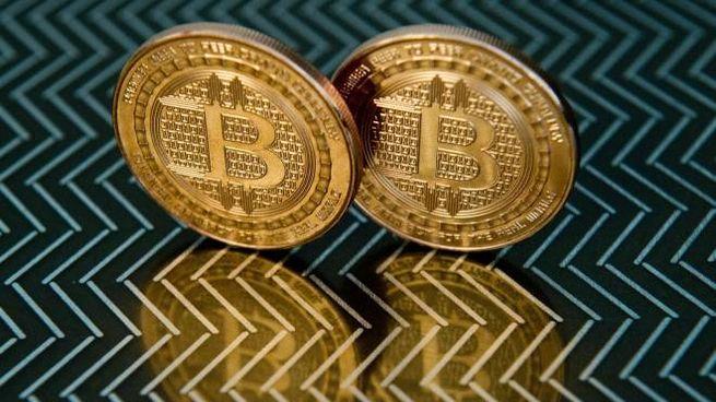 Bitcoin, valore alle stelle: nuovo record (foto Afp)