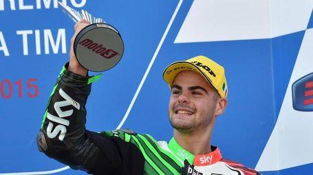 Italian Moto3 rider Romano Fenati of the Sky Racing Team VR46 celebrates on the podium his third place in the Grand Prix of Italy at the Mugello circuit, Scarperia, central Italy, 31 May 2015.    ANSA/ETTORE FERRARI