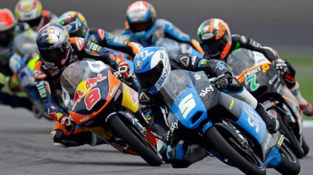 Romano Fenati, of Italy, (5) leads Efren Vazquez, of Spain, (7) and Jack Miller, of Australia, (8 )through a turn on his way to winning Indianapolis Moto 3 motorcycle race at the Indianapolis Motor Speedway in Indianapolis, Sunday, Aug. 10, 2014.  (AP Photo/Michael Conroy)