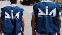 Due poliziotti della DIA (Afp)