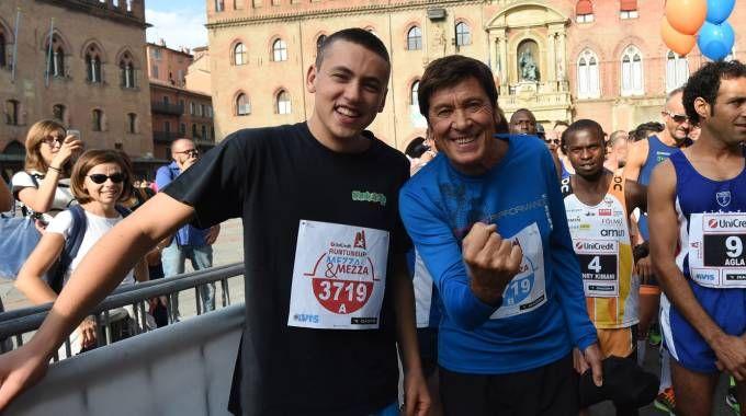 Gianni Morandi con il figlio Pietro alla 'Run Tune Up 2015' (Schicchi)