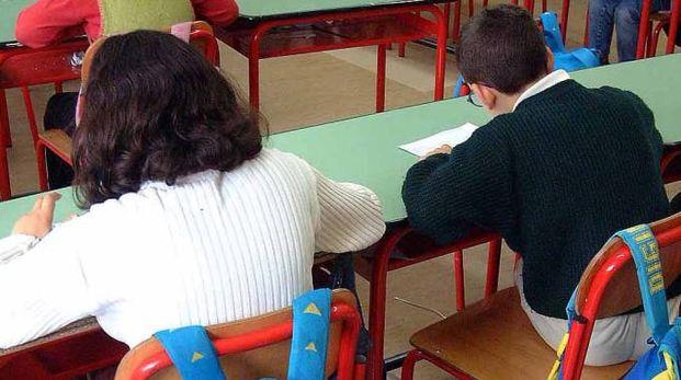 Alunni a lezione a scuola in un'immagine d'archivio (Businesspress)