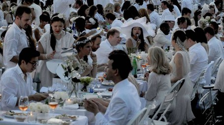 PEOPLE ATTEND DINER EN BLANC (FRENCH FOR DINNER IN WHITE), A POP-UP DINNER HELD ONCE A YEAR IN NEW YORK ON AUGUST 25, 2014 IN THE BATTERY PARK CITY NEIGHBORHOOD OF NEW YORK CITY. APPROXIMATELY 5, 000 PEOPLE ATTENDED THE DINNER.