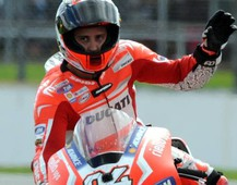Italy's Andrea Dovizioso of Ducati waves to fans after coming fifth during the British Grand Prix Moto GP race at Silverstone, England, Sunday, Aug. 31, 2014. (AP Photo/Rui Vieira)