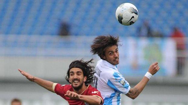 Il giocatore del Livorno Piermario Morosini (a sinistra) prima del malore fatale