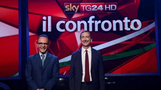 I due sfidanti al ballottaggio Stefano Parisi e Giuseppe Sala negli studi televisivi di Sky