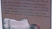 Nigeriano ucciso a Fermo: uno dei cartelli lasciati sul luogo della tragedia (Foto Zeppilli)