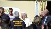 Papa Francesco nella tendopoli di Borgo di Arquata (Ansa)