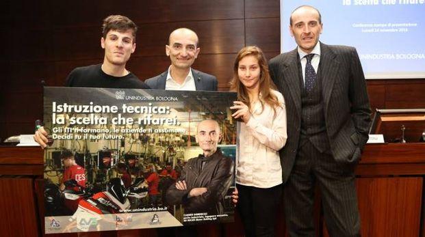 Mirco e Vanessa, i due testimonial dell'iniziativa, insieme con Claudio Domenical (Ducati) e Alberto Vacchi (Unindustria)