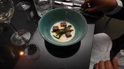 Fonduta valdostana con cicoria ripassata, sapore di tartufo e millepunti di vitello