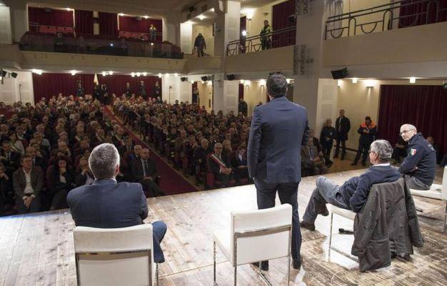 Renzi al teatro don Bosco di Macerata (Ansa)