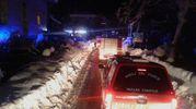 La fila dei mezzi dei vigili del fuoco (Ansa)