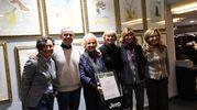 Alcuni dei partecipanti alla Notte bianca alla concessionaria Car di via Pietramellara (foto Schicchi)