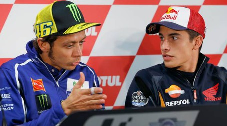 Italy's rider Valentino Rossi, left, chats with Spain's rider Marc Marquez during a press conference ahead of Sunday's Japanese Motorcycle Grand Prix at Twin Ring Motegi circuit in Motegi, north of Tokyo, Japan, Thursday, Oct. 9, 2014. (AP Photo/Shizuo Kambayashi)