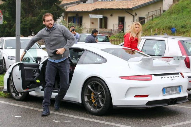 Tomaso Trussardi and wife Michelle Hunziker with their white Porshe