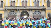 I migranti ospitati alla caserma Montello alla partenza della Stramilano 2017 (Newpress)