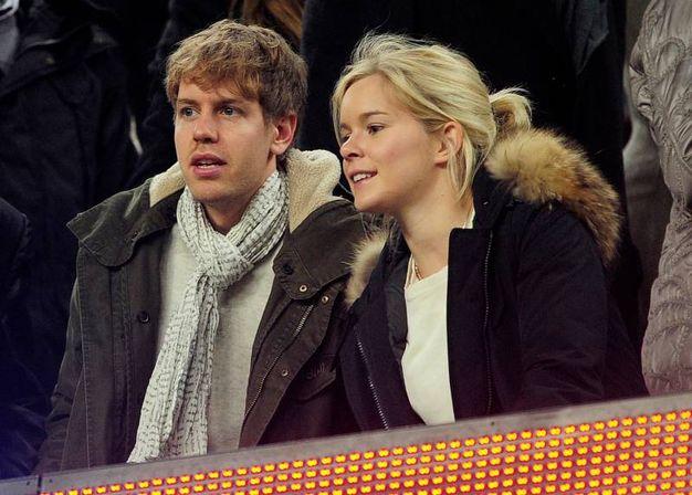 I coniugi Vettel vivono in Svizzera e hanno due figli: Emily e Matilda (Afp)