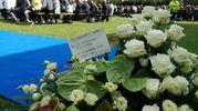 Un momento dei funerali di Scarponi (foto Ansa)