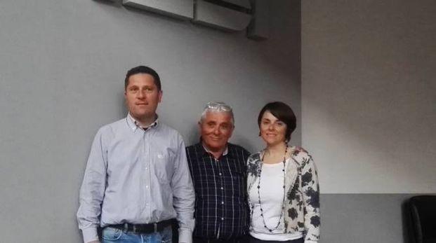 Elio Zini con i figli Luca e Federica al termine dell'asta