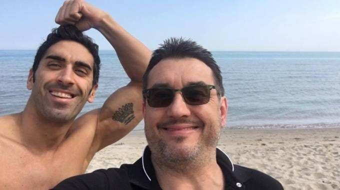 Il campione di nuoto Filippo Magnini e il medico Guido Porcellini