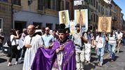 La processione 'di riparazione' (foto Artioli)