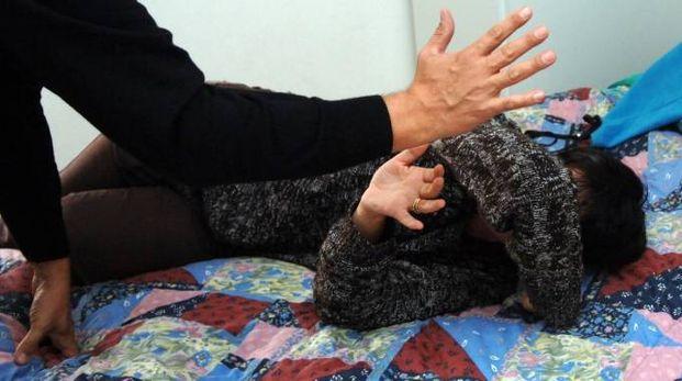 Donna maltrattata dal marito (foto repertorio)