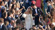 Gli sposi all'uscita dalla chiesa (Ansa)
