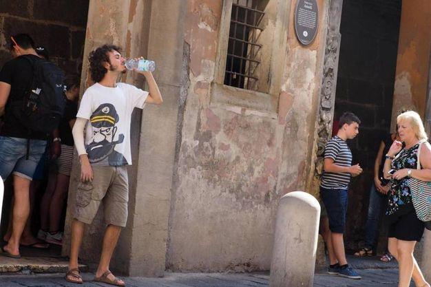 Caldo eccezionale a Bologna (foto Ansa)