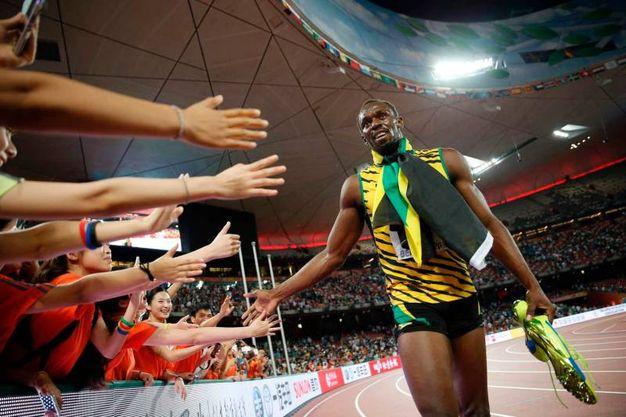 Imbattuto, imbattibile: il più grande velocista di sempre conquista l'oro nei 100 e 200 metri piani e nella staffetta ai Mondiali di Pechino nel 2015 (Afp)