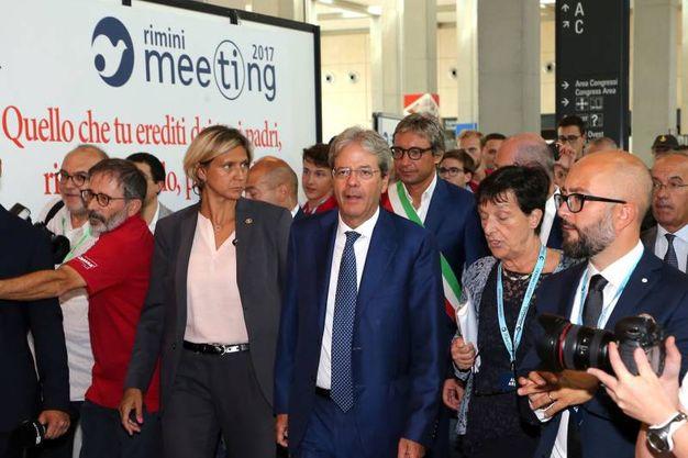 L'arrivo del premier Paolo Gentiloni al Meeting di Rimini (foto LaPresse)