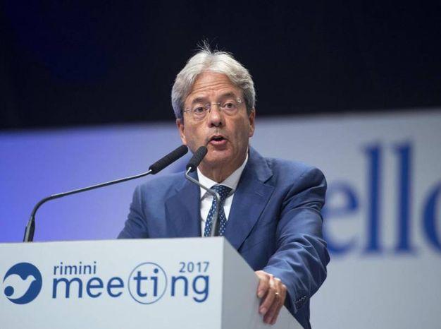 L'intervento di Gentiloni al Meeting (foto Ansa)