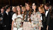 Green Carpet Fashion Awards. Maria Grazia Cucinotta con la figlia Giulia e Lavinia Biagiotti (Newpress)