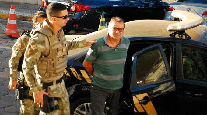 L'ex terrorista Cesare Battisti dopo l'arresto (Afp)