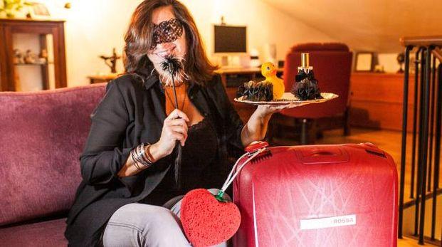 Barbara Olivi, la riminese che rappresenta in zona l'azienda della  Valigia Rossa, che commercializza prodotti dedicati al piacere  e alla salute erotica delle coppie