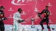 Pioggia di champagne sul podio (Afp)