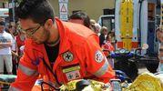 Un soccorso gestito dal personale del 118 e da volontari (immagine di repertorio)