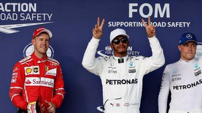 Vettel, Hamilton e Bottas (Afp)