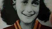 Gli adesivi con l'immagine di  Anna Frank con la maglia della Roma (Ansa)