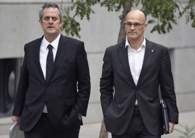 Gli ex ministri catalani arrivano in tribunale (Afp)