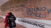 Le scritte comparse sulla chiesa contro don Lorenzo Guidotti (Foto Schicchi)