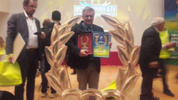 Il giornalista de La Nazione online Roberto Davide Papini con i premi
