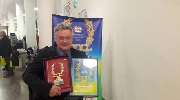 Il giornalista de La Nazione Roberto Davide Papini con i premi