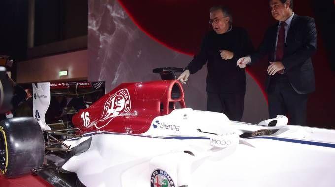 Pascal Picci e Sergio Marchionne presentano la Alfa Romeo Sauber (Afp)