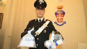I carabinieri con i flaconi di tallio sequestrati