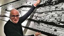 Giovanni Tortelli ha curato l'allestimento della mostra d'inaugurazione del Meis